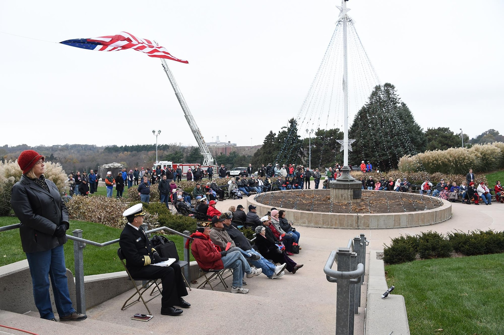 Veterans and other members of the Omaha community listen to speakers during a Veterans Day ceremony at Memorial Park in Omaha, Neb., Nov. 11, 2017. More than 200 people attended the ceremony to honor the service and sacrifice of American veterans and their families.