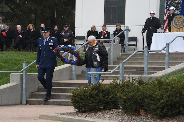 U.S. Air Force Gen. John Hyten, commander of U.S. Strategic Command, and Lonnie Ford, a Gold Star father, carry a wreath during a Veterans Day ceremony at Memorial Park in Omaha, Neb., Nov. 11, 2017. Ford's son, U.S. Army Sgt. Joshua Ford, was killed July 31, 2000, during combat operations in Al Numaniyah, Iraq. More than 200 people attended the ceremony to honor the service and sacrifice of American veterans and their families.