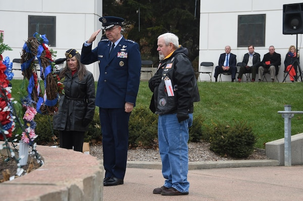 U.S. Air Force Gen. John Hyten, commander of U.S. Strategic Command, and Lonnie Ford, a Gold Star father, pay respects after placing a wreath to honor the sacrifice of American veterans during a Veterans Day ceremony at Memorial Park in Omaha, Neb., Nov. 11, 2017. Ford's son, U.S. Army Sgt. Joshua Ford, was killed July 31, 2000, during combat operations in Al Numaniyah, Iraq. More than 200 people attended the ceremony to recognize the service of American veterans and their families.