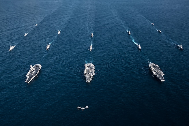 Jets and ships are seen from above.