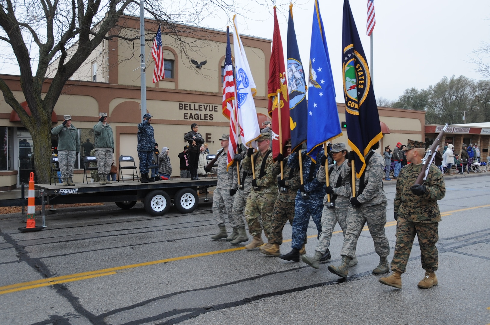 Senior leaders from U.S. Strategic Command (USSTRATCOM), the 55th Wing and the local community pay respects to the United States flag during the 2017 Bellevue Veterans Day Parade in Bellevue, Neb., Nov. 11, 2017. In addition to the parade, USSTRATCOM and 55th Wing leaders also participated in Veterans Day events at Memorial Park and the Eastern Nebraska Veterans Home to honor the service and sacrifice of American veterans and their families.