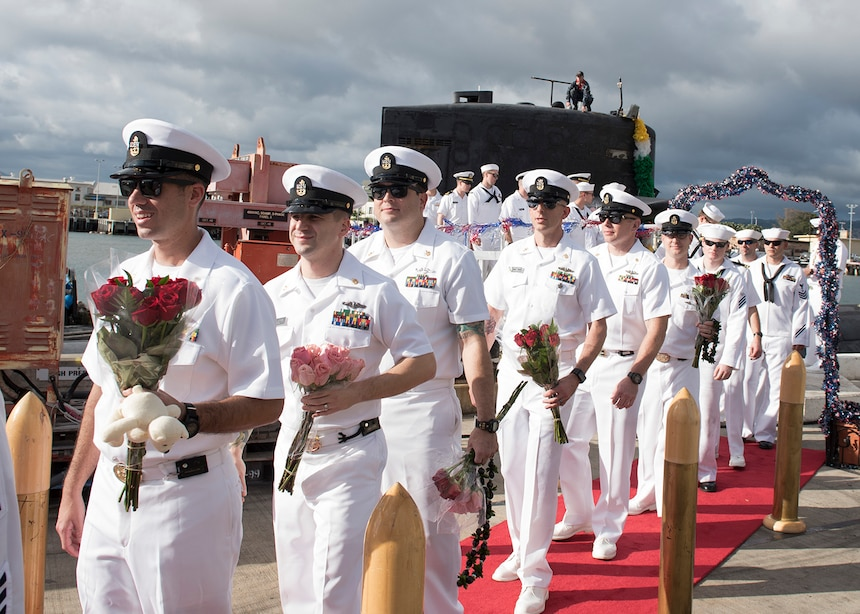 USS Olympia (SSN 717) prepare to greet their loved ones following their return from a six-month deployment, Nov. 9. (U.S. Navy Photo by Mass Communication Specialist 2nd Class Shaun Griffin/Released)