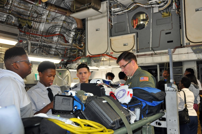 Master Sgt. Kiley Gerritsen, 445th Aeromedical Evacuation Squadron medical technician, shows students from Thurgood Marshall and Meadowdale High Schools some of the equipment his squadron uses when flying on an AE mission. (U.S. Air Force photo/Stacy Vaughn)