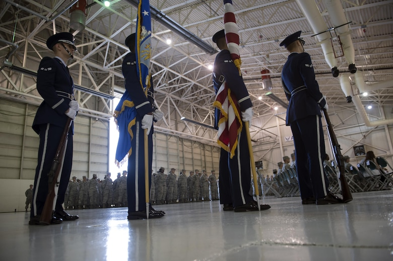 Moody Honor Guardsmen await the start of the 23d Maintenance Squadron re-designation ceremony, Nov. 9, 2017, at Moody Air Force Base, Ga. Lt. Col. Neal Van Houten took command of Air Combat Command's second largest squadron, leading the 800 men and women who are responsible for executing safe and reliable maintenance on aircraft systems, ground equipment and munitions to support the 23d Wing's attack and rescue missions. (U.S. Air Force photo by Senior Airman Greg Nash)