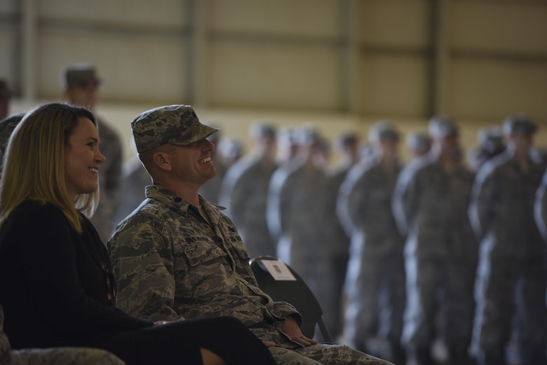 Lt. Col. Neal Van Houten, former 23d Equipment Maintenance Squadron commander, shares a laugh before taking command of the newly re-designated 23d Maintenance Squadron, Nov. 9, 2017, at Moody Air Force Base, Ga. Van Houten took command of Air Combat Command's second largest squadron, leading the 800 men and women who are responsible for executing safe and reliable maintenance on aircraft systems, ground equipment and munitions to support the 23d Wing's attack and rescue missions. (U.S. Air Force photo by Senior Airman Greg Nash)