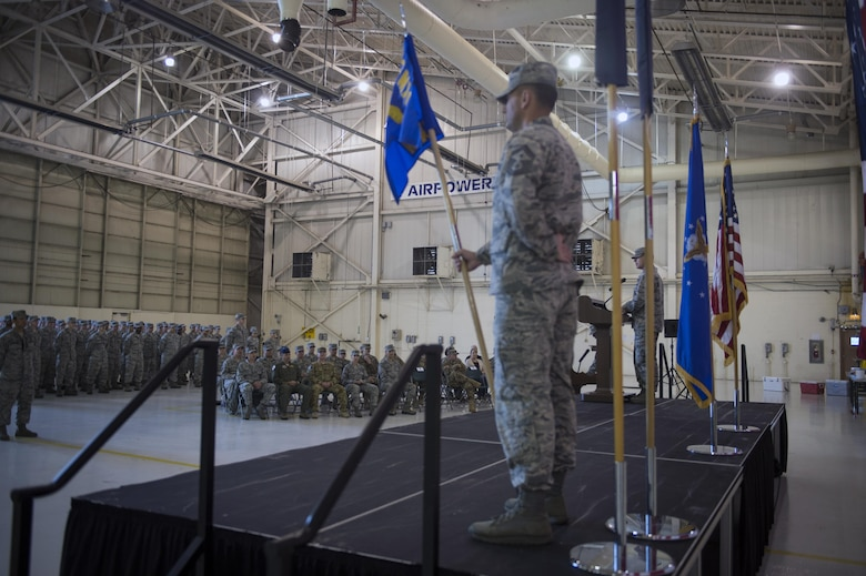 Lt. Col. Neal Van Houten, 23d Maintenance Squadron commander, commends 23d MXS Airmen for their maintenance professionalism and expertise during a re-designation ceremony, Nov. 9, 2017, at Moody Air Force Base, Ga. Van Houten took command of Air Combat Command's second largest squadron, leading the 800 men and women who are responsible for executing safe and reliable maintenance on aircraft systems, ground equipment and munitions to support the 23d Wing's attack and rescue missions. (U.S. Air Force photo by Senior Airman Greg Nash)