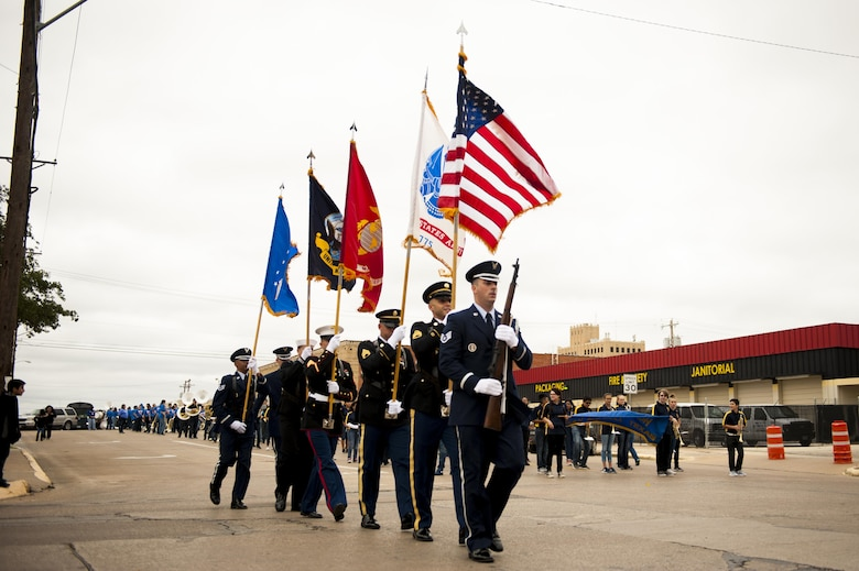 Goodfellow color guard finishes their parade route for the Veteran's Day parade in San Angelo, Texas, Nov. 13, 2017. Over 400 military members participated in the parade. (U.S. Air Force photo by Senior Airman Scott Jackson/Released)