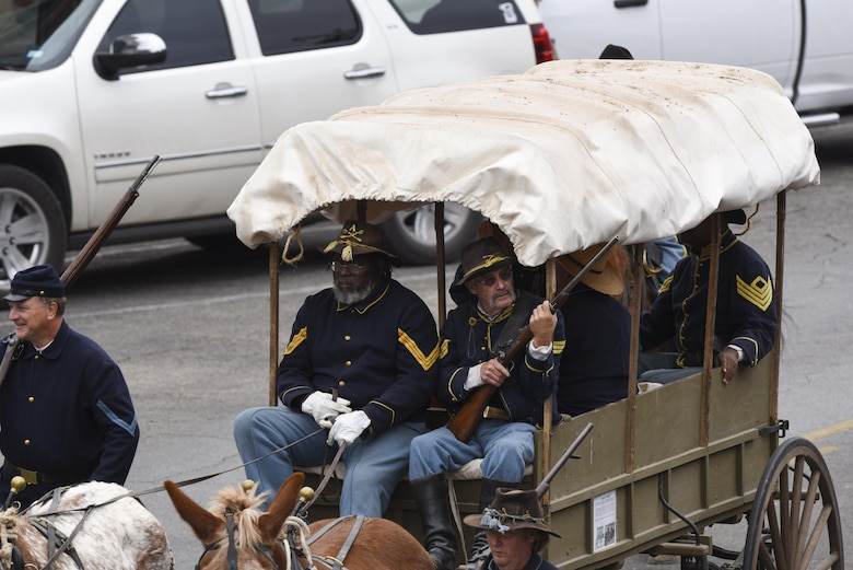 Fort Concho volunteers take part in the Veteran's Day Parade in San Angelo, Texas, Nov. 11, 2017. Volunteers in historically accurate attire, rode in a horse drawn carriage along the parade route through downtown. (U.S. Air Force photo by Airman 1st Class  Zachary Chapman/Released)