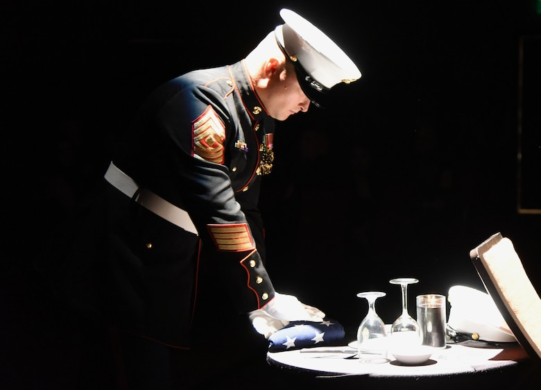 First Sgt. Earl DeLack, Keesler Marine Detachment first sergeant, performs a POW/MIA remembrance ceremony during the 242nd Marine Corps Birthday Ball at the Golden Nugget Casino Nov. 10, 2017, in Biloxi, Mississippi. More than 300 service members and guests attended the Keesler Marine Detachment-hosted event. (U.S. Air Force photo by Kemberly Groue)