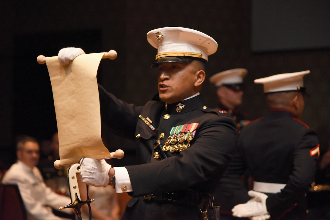 Chief Warrant Officer 3 Andres Madera, Keesler Marine Detachment meteorology and oceanography analyst forecaster course officer in charge, reads a birthday message from Gen. John A. Lejeune during the 242nd Marine Corps Birthday Ball at the Golden Nugget Casino Nov. 10, 2017, in Biloxi, Mississippi. More than 300 service members and guests attended the Keesler Marine Detachment-hosted event. (U.S. Air Force photo by Kemberly Groue)