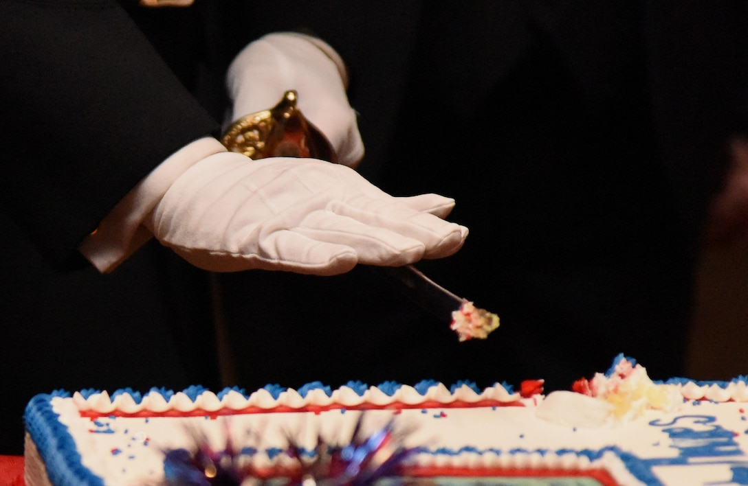Capt. Gary Baxter, Keesler Marine Detachment commanding officer, cuts the birthday cake using a non-commissioned officer sword during the 242nd Marine Corps Birthday Ball at the Golden Nugget Casino Nov. 10, 2017, in Biloxi, Mississippi. More than 300 service members and guests attended the Keesler Marine Detachment-hosted event. (U.S. Air Force photo by Kemberly Groue)