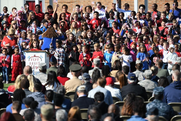 Students at Jeff Davis Elementary School sing patriotic songs during a Veterans Day celebration Nov. 10, 2017, in Biloxi, Mississippi. During the event, students also recited the Pledge of Allegiance. Keesler Air Force Base leadership, honor guardsmen and base personnel attended the event. (U.S. Air Force photo by Kemberly Groue)