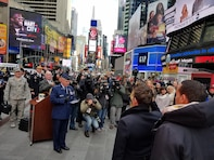 Major General Garrett Harencak, Commander, Air Force Recruiting Service, swears in new recruits at the Times Square Ribbon Cutting Ceremony