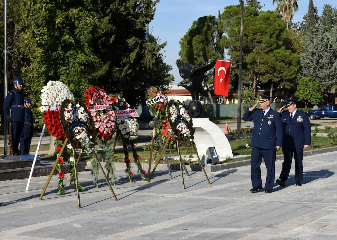 Turkish Air Force Col. Kursad Yildiz, 10th Tanker Base wing commander, and U.S. Air Force Col. Michael Rimsky, 39th Air Base Wing vice commander, render salutes as a display of respect for Mustafa Kemal Ataturk at Incirlik Air Base, Turkey, Nov. 10, 2017.