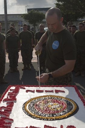 MCAS FUTENMA, OKINAWA, Japan— Lt. Col. Richard Ashford cuts the cake during the Cake Cutting Ceremony after the 242-mile Birthday Run on Marine Corps Air Station Futenma, Okinawa, Japan.