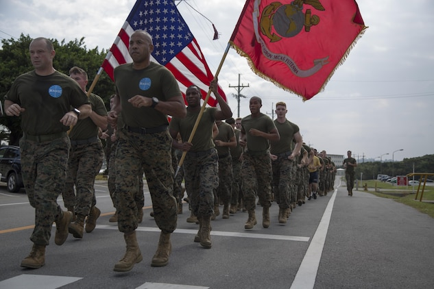 MCAS FUTENMA, OKINAWA, Japan— Marines and sailors run in formation during the 242-mile Birthday Run on Marine Corps Air Station Futenma, Okinawa, Japan.