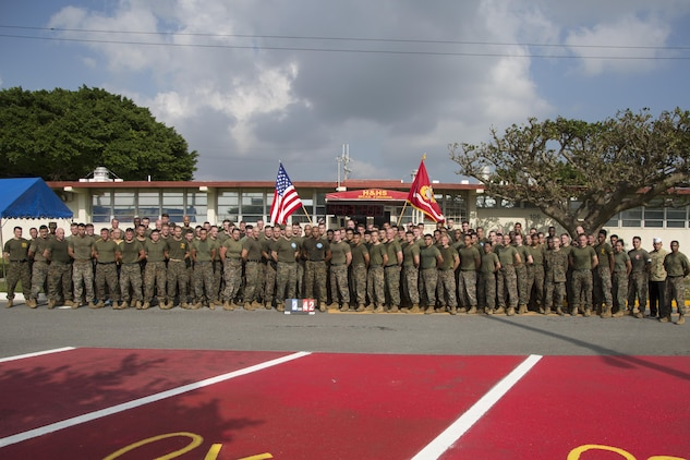 MCAS FUTENMA, OKINAWA, Japan— Marines and sailors pose for a group photo after the 242-mile Birthday Run on Marine Corps Air Station Futenma, Okinawa, Japan.