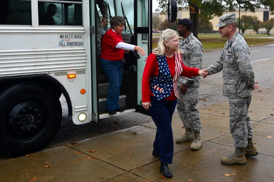 Members of the Quilts of Valor Foundation (QOVF) are greeted by 20th Fighter Wing (FW) leadership during a QOVF event at Shaw Air Force Base, South Carolina, Nov. 9, 2017.