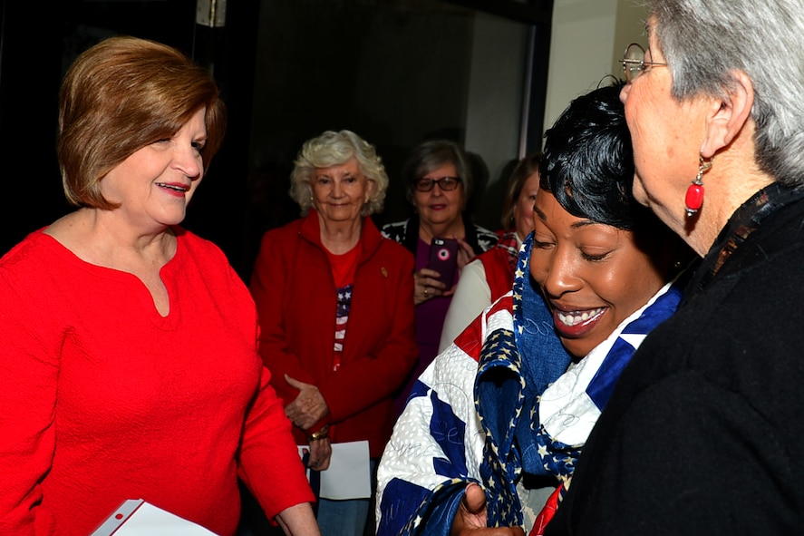 U.S. Air Force Tech. Sgt. Portia Wyatt, 20th Security Force Squadron first sergeant, is embraced by Quilts of Valor Foundation (QOVF) members during a QOVF event at Shaw Air Force Base, South Carolina, Nov. 9, 2017.