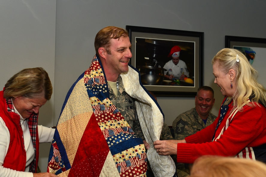 U.S. Air Force Senior Master Sgt. Daniel Henderson, 20th Aircraft Maintenance Squadron, 55th Aircraft Maintenance Unit, assistant superintendent, shares a laugh with Quilts of Valor Foundation (QOVF) members during a QOVF event at Shaw Air Force Base, South Carolina, Nov. 9, 2017.