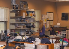 (From left) Dana Wacks, Langley Thrift Shop volunteer, and Heather Alvarado, Langley Thrift Shop manager, organize merchandise at Joint Base Langley-Eustis, Va., Oct. 12, 2017.