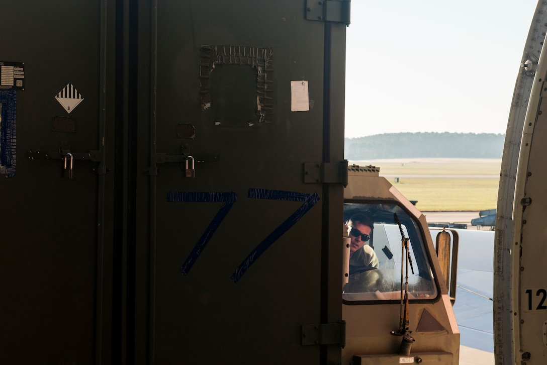 U.S. Air Force Tech. Sgt. Stephen Lacey, 20th Logistics Readiness Squadron air transportation specialist, loads cargo onto a Boeing 747 while operating a k-loader at Shaw Air Force Base, South Carolina, Nov. 1, 2017.