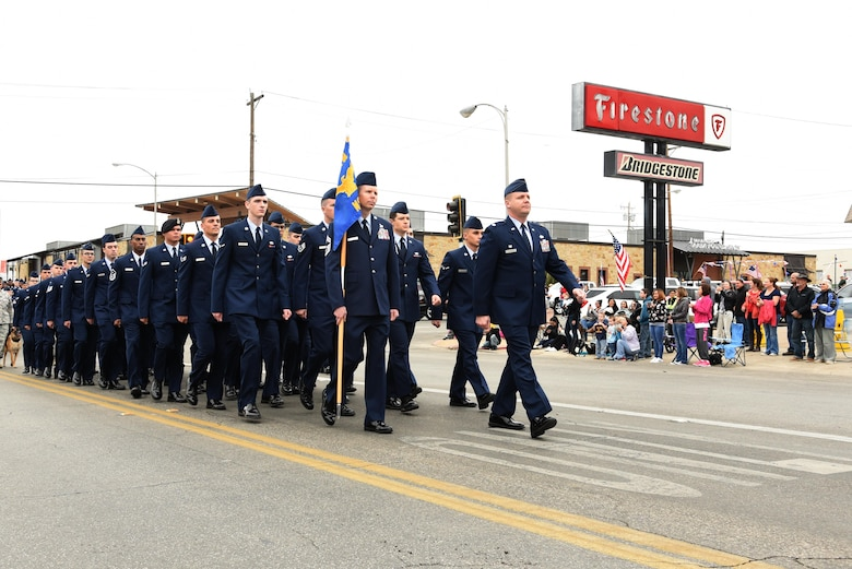 U.S. Air Force Lt. Col. John Travieso, 17th Contracting Squadron commander, and Chief Master Sgt. Franklin Chism, 17th Mission Support Group superintendent, lead the 17th Mission Support Group formation in San Angelo's Veteran's Day Parade Nov. 11, 2017, San Angelo, Texas.