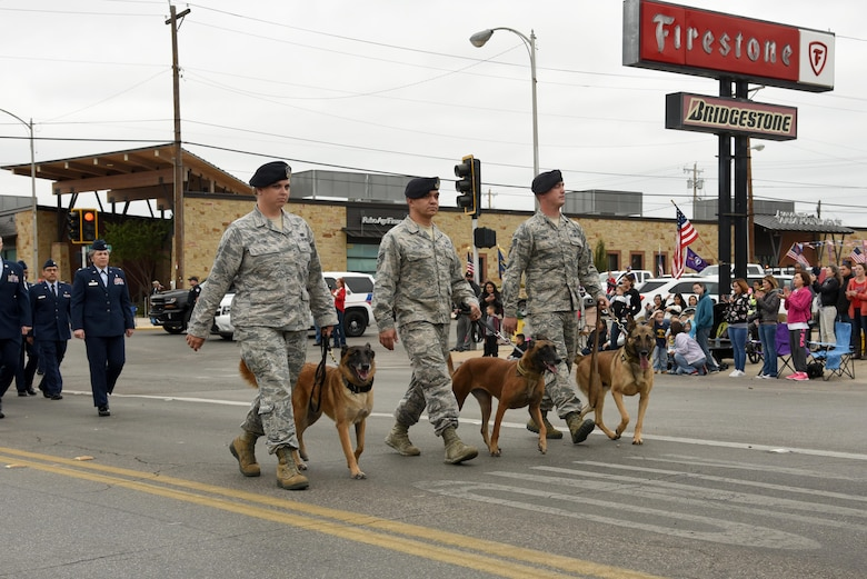 17th Security Forces Squadron military working dogs and their handlers from Goodfellow Air Force Base march in San Angelo's Veteran's Day Parade Nov. 11, 2017, San Angelo, Texas.