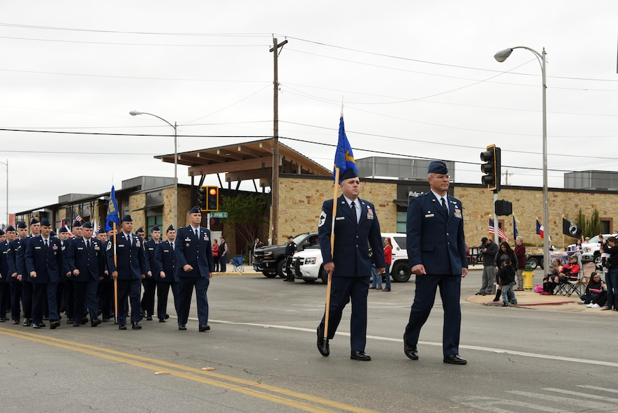 U.S. Air Force Col. Alejandro Ganster, 17th Training Group commander and Chief Master Sgt. Daniel Stein, 17th Training Group superintendent, lead the 17th Training Group formation in San Angelo's Veteran's Day Parade Nov. 11, 2017, San Angelo, Texas.