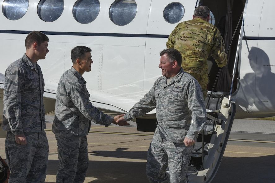 U.S. Air Force 1st Lt. Joseph McKenna, Communication Squadron officer in charge, and Col. Ricky Mills, 17th Training Wing commander, greet Maj. Gen. Timothy Leahy, 2nd Air Force commander at Mathis Field airport in San Angelo, Texas, Nov. 1, 2017. Leahy was visiting all Air Education and Training Command bases which included a three day visit to Goodfellow Air Force Base.