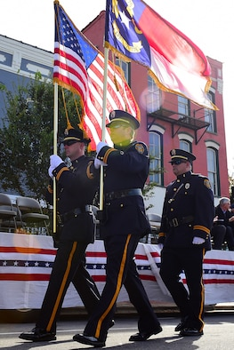 Three members of the Goldsboro Police Department march after presenting the colors to signify the start of the Wayne County Veterans Day Parade, Nov. 11, 2017, in Goldsboro, North Carolina. Goldsboro PD presented the colors alongside the Wayne County Sheriff's Office while Airman 1st Class Christopher Echevarria Arroyo, 4th Component Maintenance Squadron avionics apprentice, sang the national anthem. (U.S. Air Force photo by Airman 1st Class Kenneth Boyton)