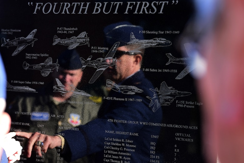 Col. Christopher Sage, 4th Fighter Wing commander, observe the new honor stone unveiled Nov. 11, 2017, at Seymour Johnson Air Force Base, North Carolina. The monument was placed in front of 4th Mission Support Group building and represents all of the Airmen from the 4th Fighter Wing who have either died in combat or became aerial aces. (U.S. Air Force photo by Airman 1st Class Kenneth Boyton)
