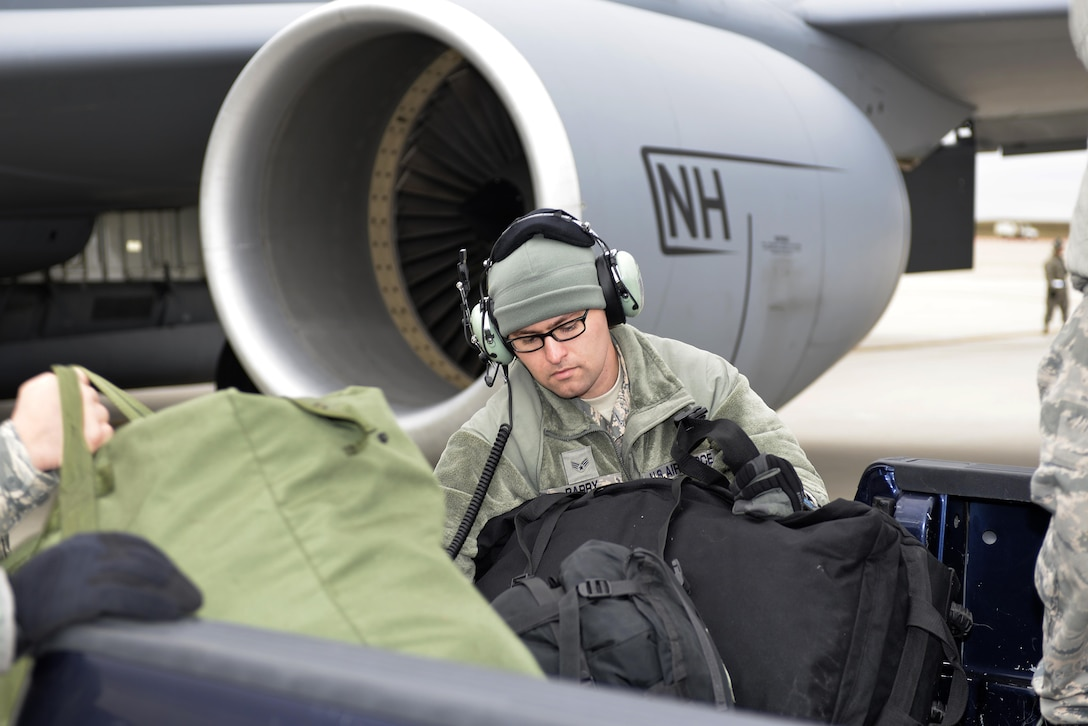 Senior Airman Brad Barry, assigned to the 64th Air Refueling Squadron, 157th Air Refueling Wing, loads bags onto a KC-135 Stratotanker for the twelve N.H. Air National Guardsmen deploying from the 260th Air Traffic Control Squadron in support of the ongoing hurricane relief efforts in Puerto Rico on November 13, 2017, at Pease Air National Guard Base, N.H. The Airmen will augment a group from the 235th ATCS, North Carolina Air National Guard, and support the air control mission in Puerto Rico.  (N.H. Air National Guard photo by Master Sgt. Thomas Johnson)