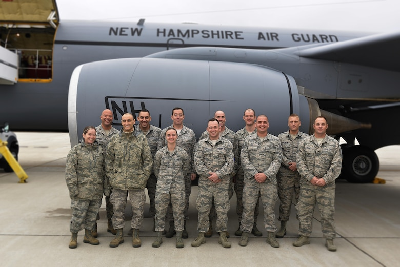 Airmen from the 260th Air Traffic Control Squadron, 157th Air Refueling Wing, pose for a group picture prior to their deployment to Puerto Rico in support of the hurricane relief effort on November 13, 2017, at Pease Air National Guard Base, N.H. They will join Airmen from the 235th ATCS, North Carolina Air National Guard, and assist in the air control mission at an airfield in PR. (N.H. Air National Guard photo by Master Sgt. Thomas Johnson)