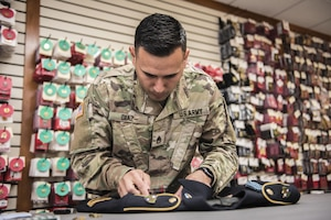 Army Reserve Staff Sgt. Luis Diaz assembles a dress uniform for use during mortuary affairs operations at the Charles C. Carson Center at Dover Air Force Base, Del., Oct. 24, 2017. The Charles C. Carson Center is home to the Port Mortuary, which is responsible for returning all Defense Department service members, civilians and contractors who perish during contingency operations overseas. Army photo by Master Sgt. Brian Hamilton