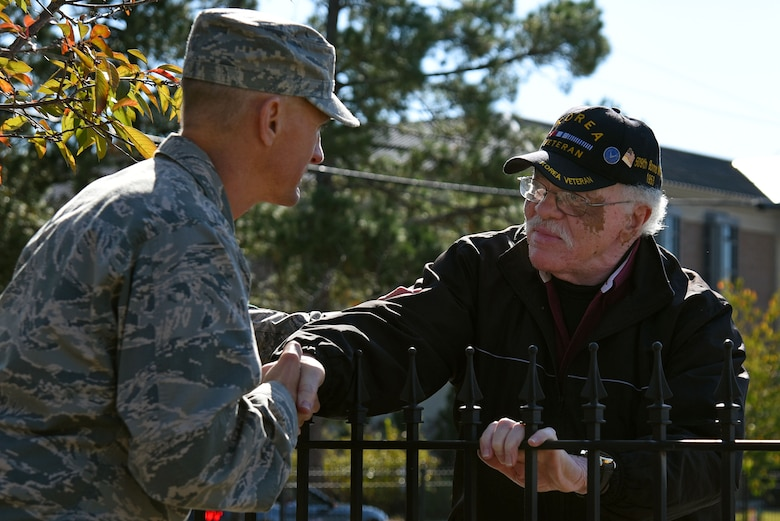 U.S. Air Force Col. Daniel Lasica, 20th Fighter Wing commander, left, shakes the hand of a veteran during a Veterans Day Celebration parade in Sumter, South Carolina, Nov. 11, 2017.