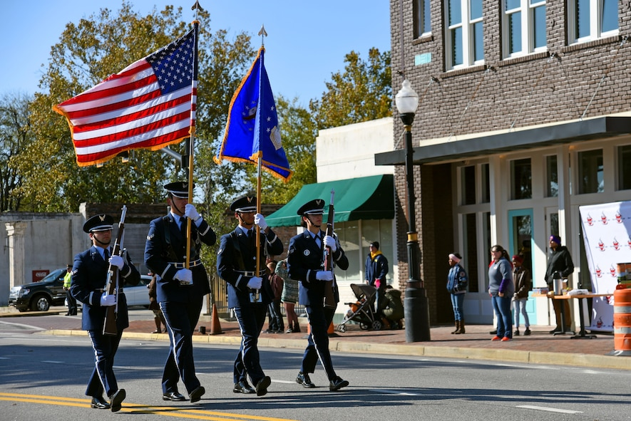 U.S. Airmen assigned to the 20th Force Support Squadron Honor Guard march during a Veterans Day Celebration parade in Sumter, South Carolina, Nov. 11, 2017.