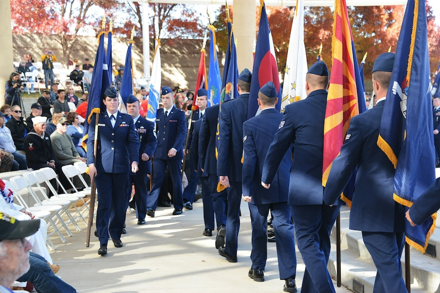 Kirtland Airmen parade the 50 state flags at the Veterans Day Ceremony Nov. 11 at the New Mexico Veterans Memorial. Past, present and future veterans were honored during the ceremony.