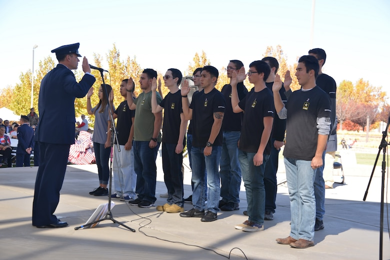Maj. Gen. Matthew Molloy, Air Force Operational Test and Evaluation Center commander, administers to enlistment oath to new Army recruits at the Veterans Day Ceremony Nov. 11 at the New Mexico Veterans Memorial.