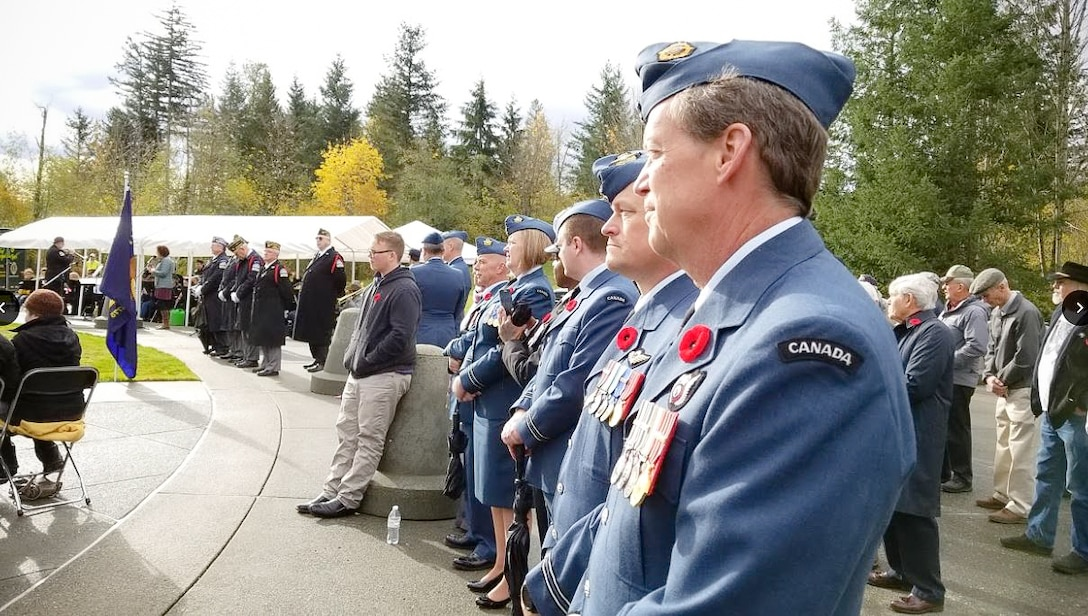 Members of the WADS Canadian Detachment await the beginning of the Veterans Day program at the Tahoma National Cemetery.  Pictured from front to back are: Capt. Todd Rose, Capt. Patrick Morris, Capt. Mark Hynes, Master Seaman Malisa Ogunniya, Capt. Barb Steele and Capt. Jordon Harpe.