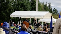 Lt. Col. Matthew Wappler, WADS Canadian Detachment commander, speaks about the Canadian effort during the Korean War and the significance of the poppy flower during the Veterans Day program at Tahoma National Cemetery.
