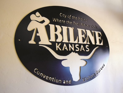 Abilene means City of the Plains. The metal sign in the Convention and Visitors Bureau showcases the city's history as the end of the Chisholm Trail.