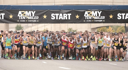 """Runners in the first wave of the Army Ten-Miler start the race at the Pentagon in Washington, D.C., Oct. 8. A team of 14 runners from the 1st Infantry Division represented the """"Big Red One"""" and Fort Riley at the race."""