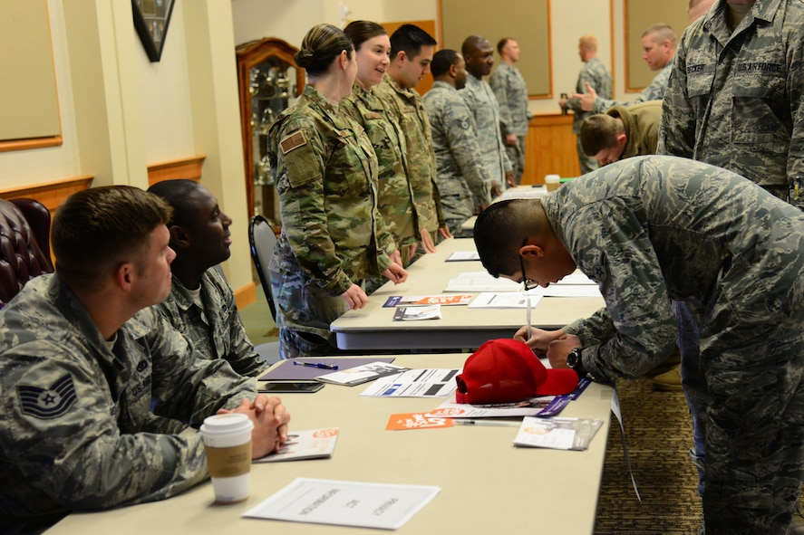 Airmen from the 819th RED HORSE Squadron representing the Combined Federal Campaign assist Airmen in volunteering at or donating to organizations Nov. 14, 2017, at Malmstrom Air Force Base, Mont. This year, CFC added volunteering opportunities for individuals to donate time to organizations of their choice. (U.S. Air Force photo by Airman 1st Class Tristan Truesdell)
