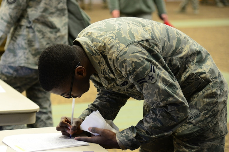 An Airman at the Combined Federal Campaign ceremony signs up to participate in the kickoff Nov. 14, 2017, at Malmstrom Air Force Base, Mont. The goal of the ceremony was to provide complete contact between individuals and organizations. (U.S. Air Force Photo by Airman 1st Class Tristan Truesdell)
