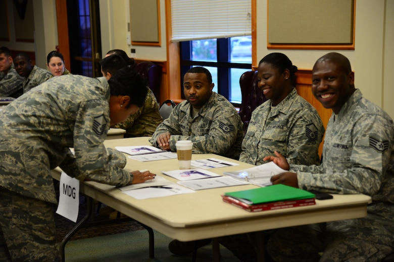 Combined Federal Campaign representatives from the 341st Medical Group provide information and sign-up sheets for members of their group Nov. 14, 2017, at Malmstrom Air Force Base, Mont. Airmen can volunteer to become unit representatives to spread awareness for the CFC. (U.S. Air Force photo by Airman 1st Class Tristan Truesdell)
