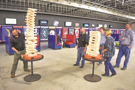 Fort Riley garrison staff join in a game of GIANT Jenga at the internal garrison organization day Oct. 5 at the Custer Hill Bowling Center.