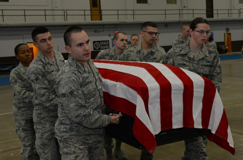 Airmen assigned to the Ellsworth Air Force Base, S.D., Honor Guard, carry a casket during a training exercise in the United States Air Force Honor Guard Mobile Training Team event at the Pride Hangar on base, Oct. 26, 2017. The honor guard flight underwent a week-and-a-half long course in basic protocol, honors and ceremonies. (U.S. Air Force photo by Airman Nicolas Z. Erwin)