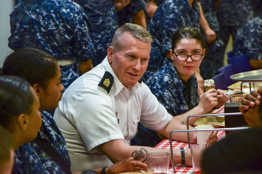 The senior enlisted advisor to the Chairman of the Joint Chiefs of Staff dines with sailors.