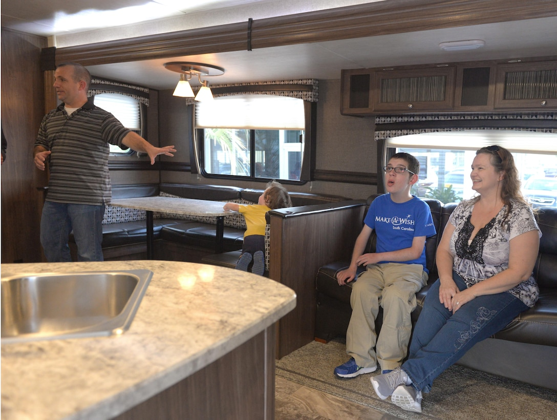 Capt. Steven Braddick explores his family's new camper trailer with his two-year-old Nicholas, 16-year-old Nathan and his wife, Renee on November 7, 2017 in Charleston, S.C. Nathan was selected to receive a gift from the Make-A-Wish Foundation due to his severe illness, MECP2 duplication syndrome.